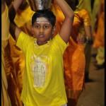 Younger devotee carrying milk pot
