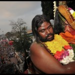 A devotee carrying a statue of Lord Muruga