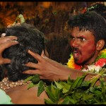 """A tranced devotee """"waking up"""" another tranced devotee on a special ritual"""